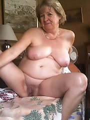 Older grannies spreading pussy