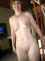 Sweet mature momma taking off her clothes