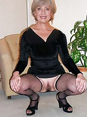 Young-looking experienced housewife playing with her hole