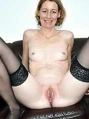 Sexy older MILF spreading her pussy on photo
